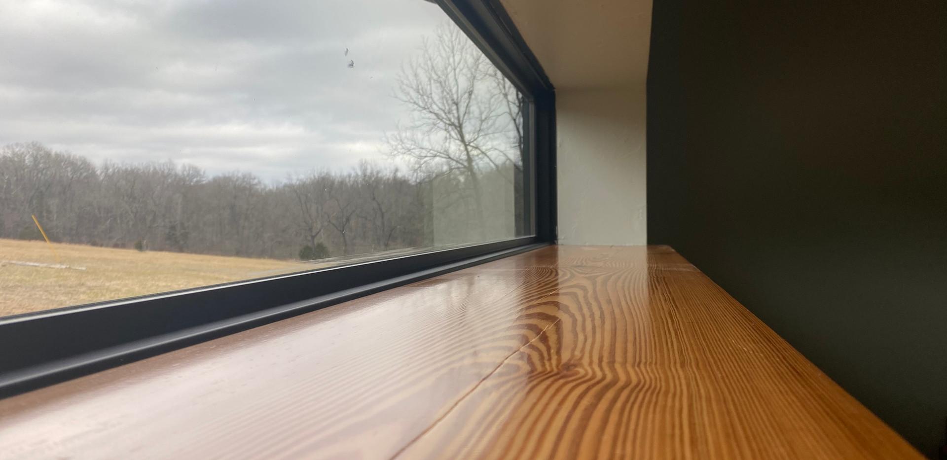 Reclaimed pine on window sills.