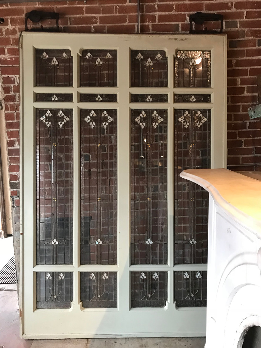 Lead glass sliding door with mother of pearl and gold inlay.