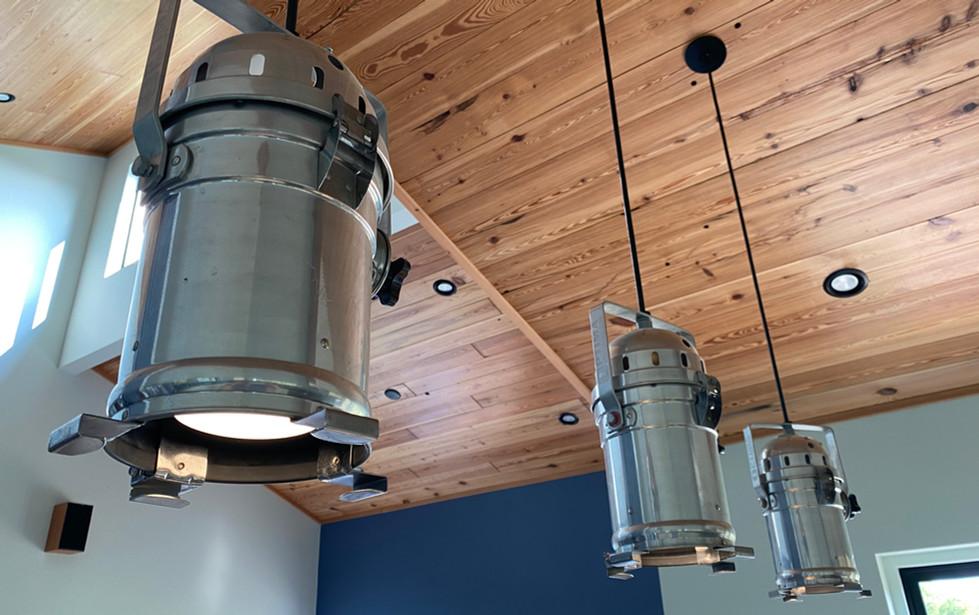 Reclaimed pine on ceilings.