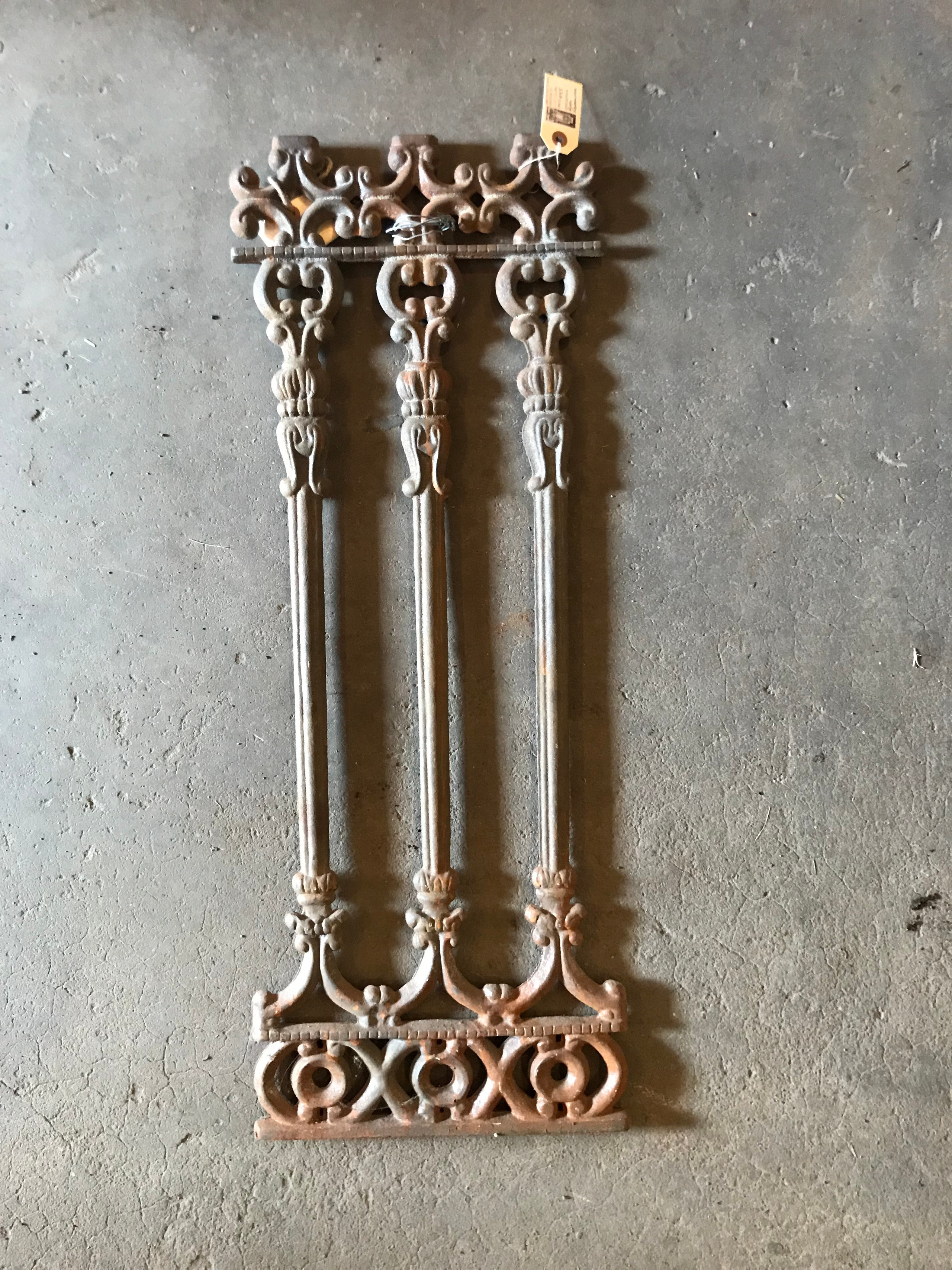 cast iron replica with three shafts for a fence row.