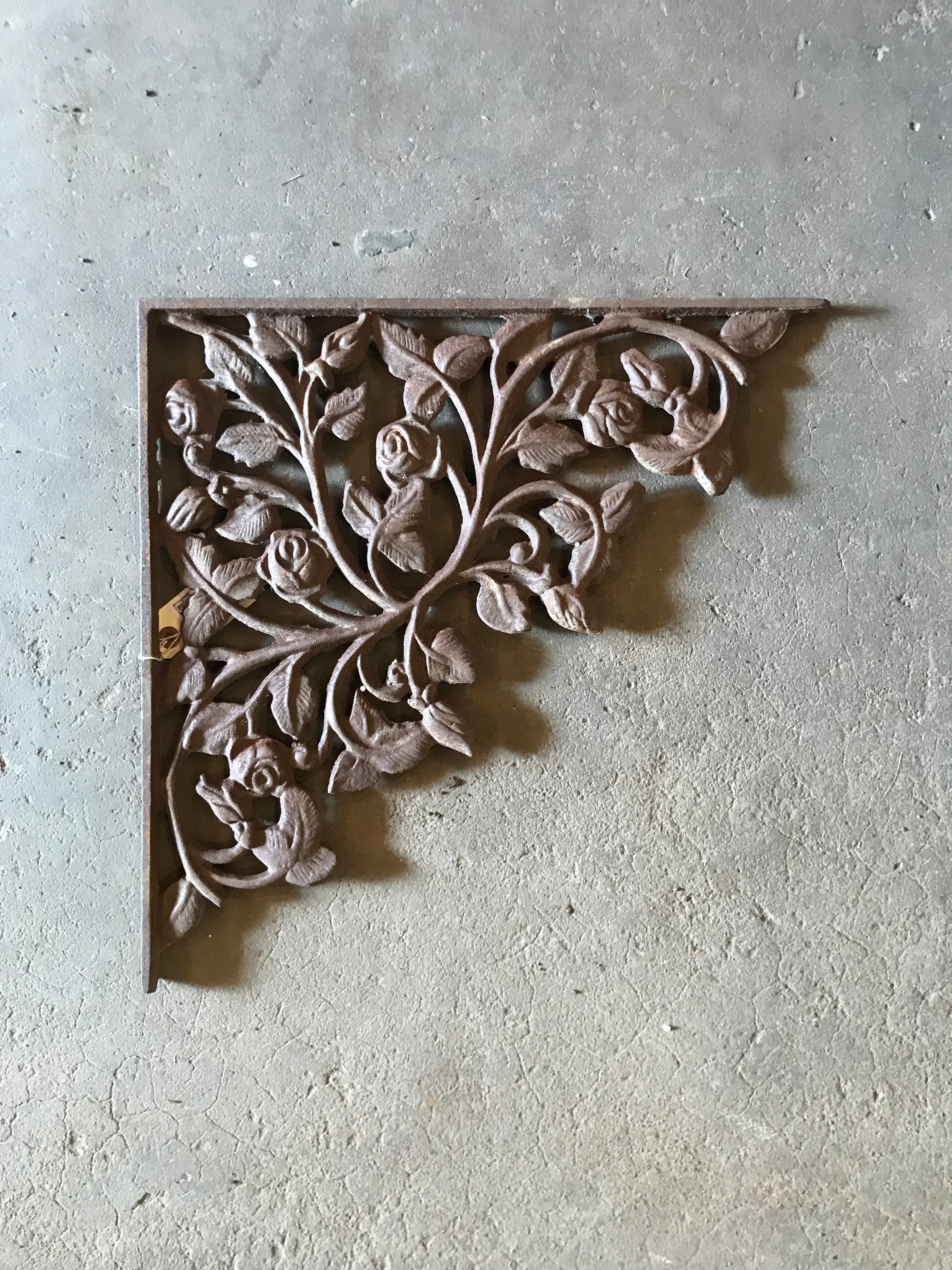 cast iron corner bracket with roses on the vine.