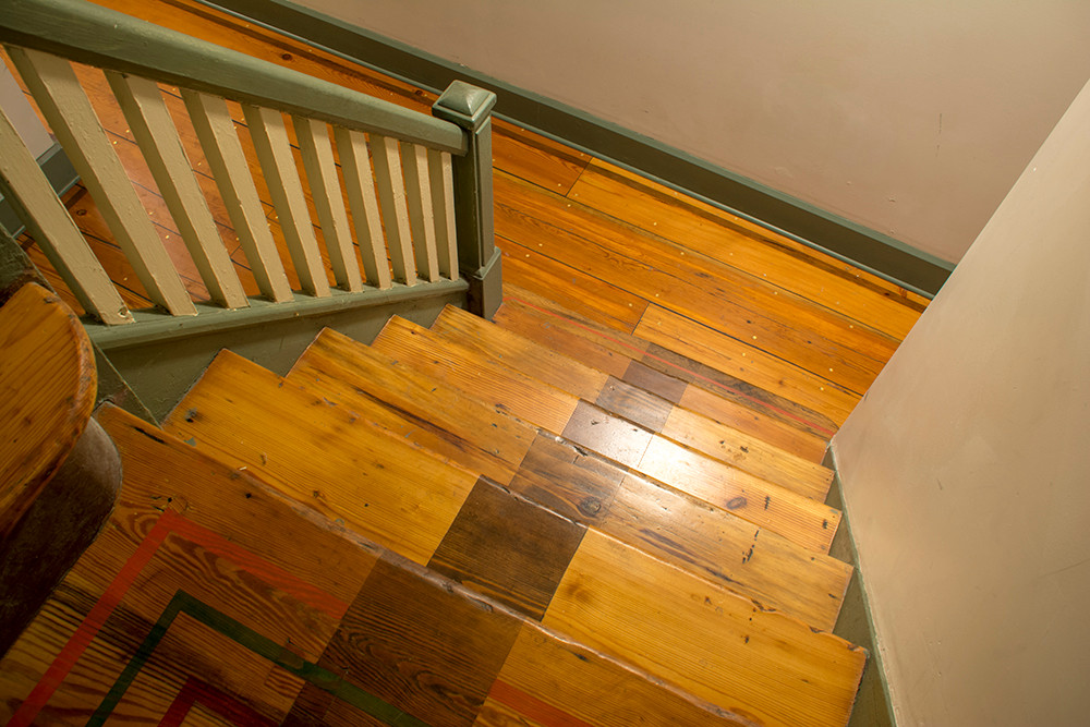 Reclaimed basketball court wood used in a staircase in St. Louis MO.
