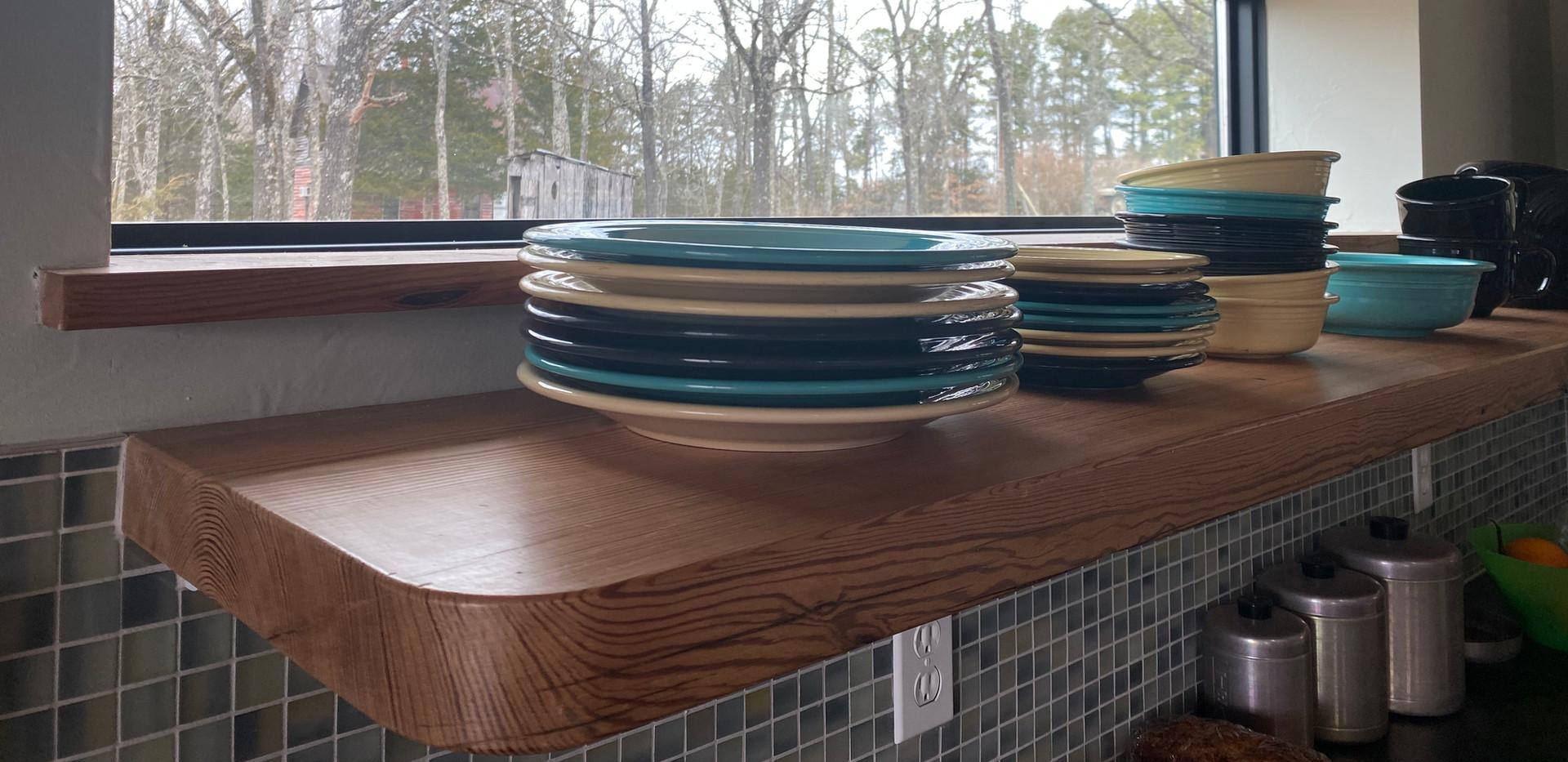 Reclaimed pine floating shelves.