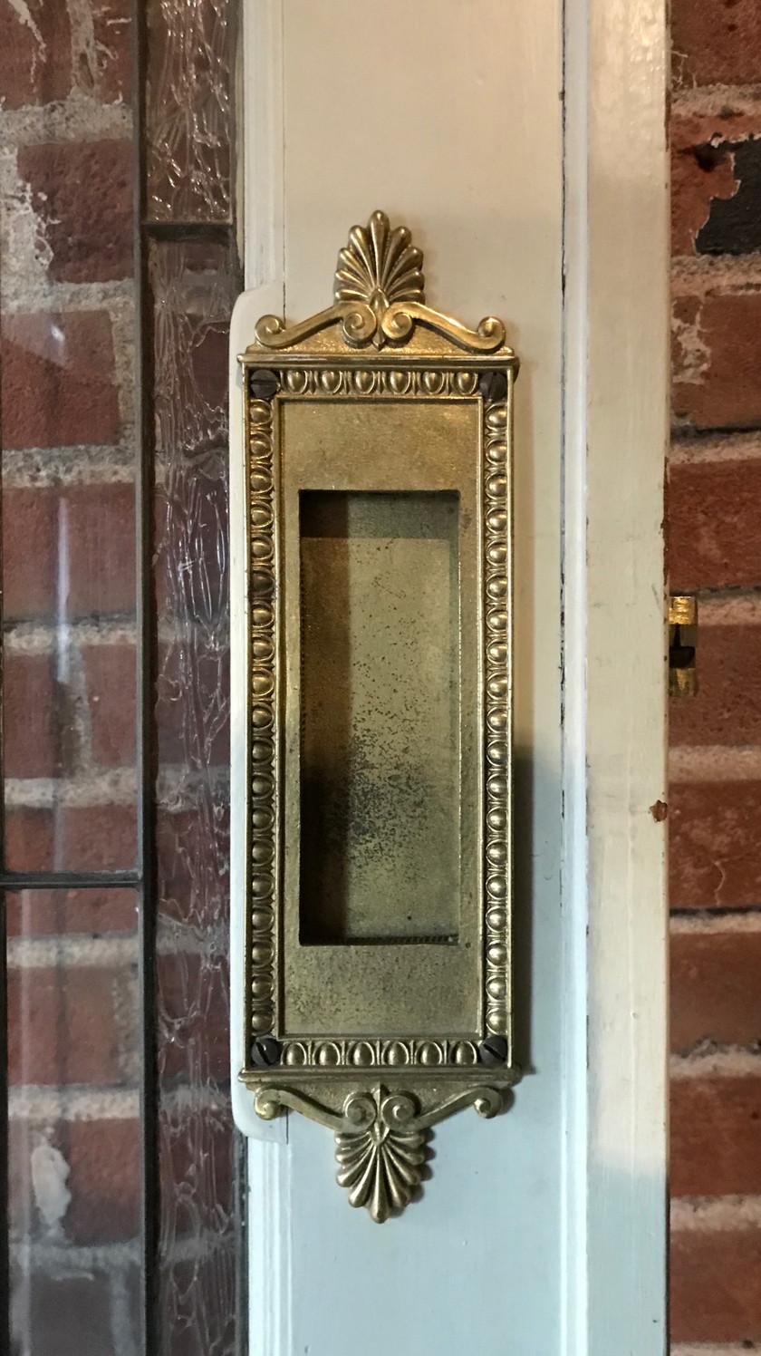 Original door hardware on the lead glass and inlay door.