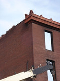 Red terra cotta parapet caps, architectural salvage from St. Louis Mo.