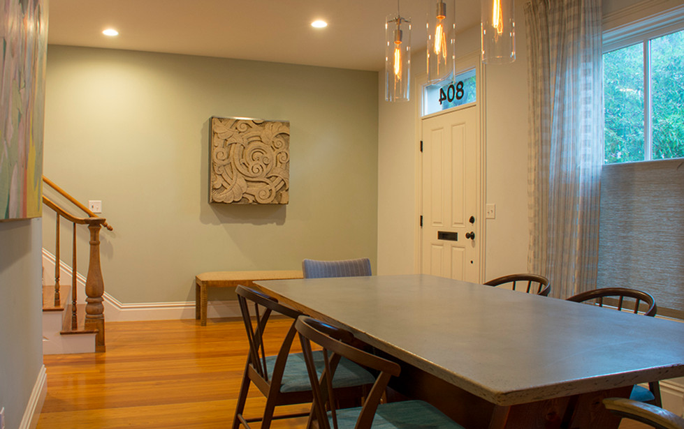 Reclaimed pine floor. Architectural Artifacts of St. Louis hanging on the wall.
