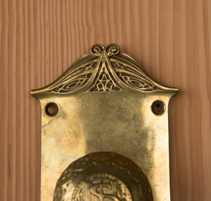 Top of the door knob plate showing the intricate details.