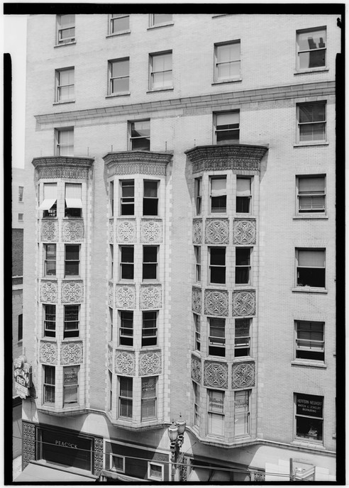 Detail photo of the St. Nicholas Hotel, showing window bays.