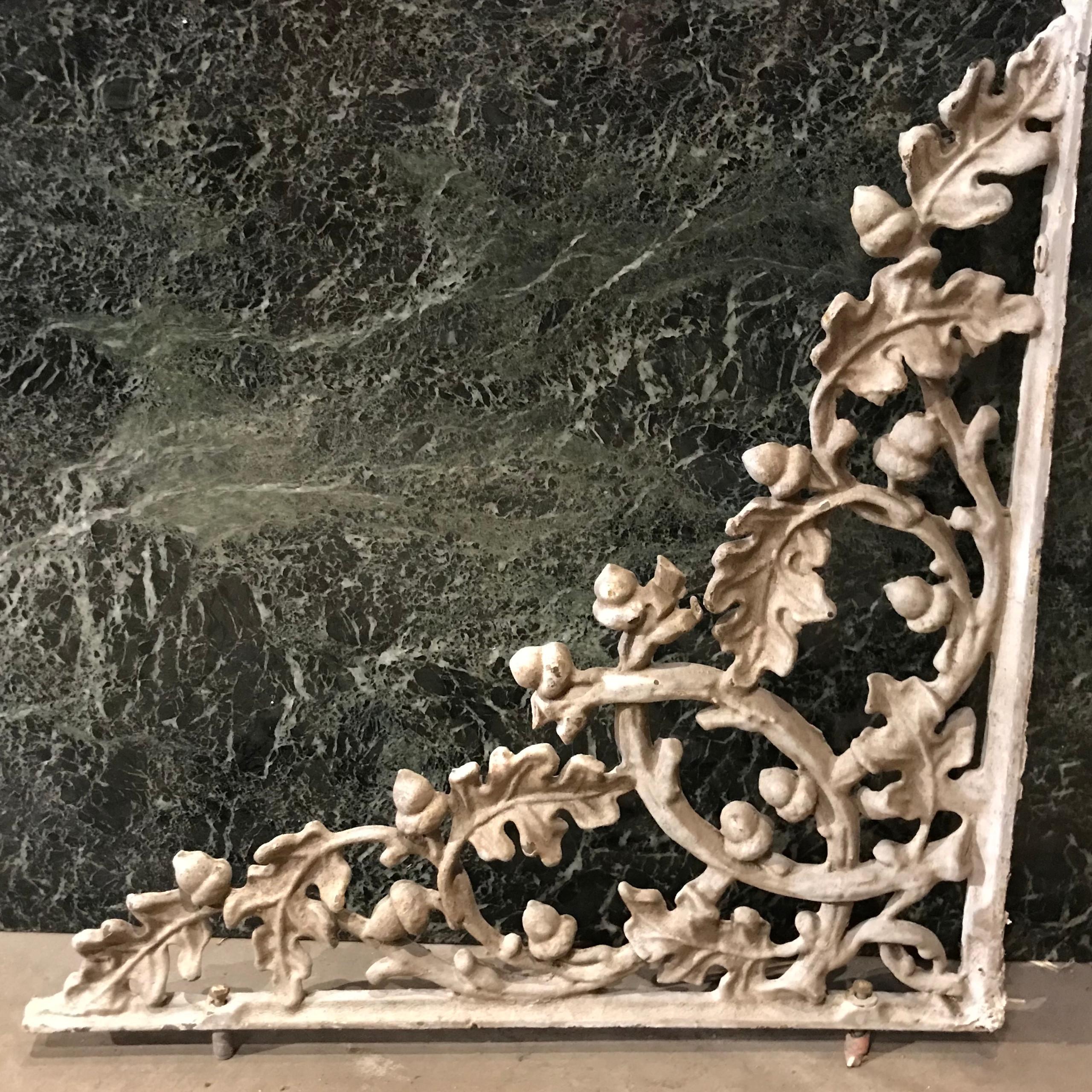 Iron brackets with oak motif.