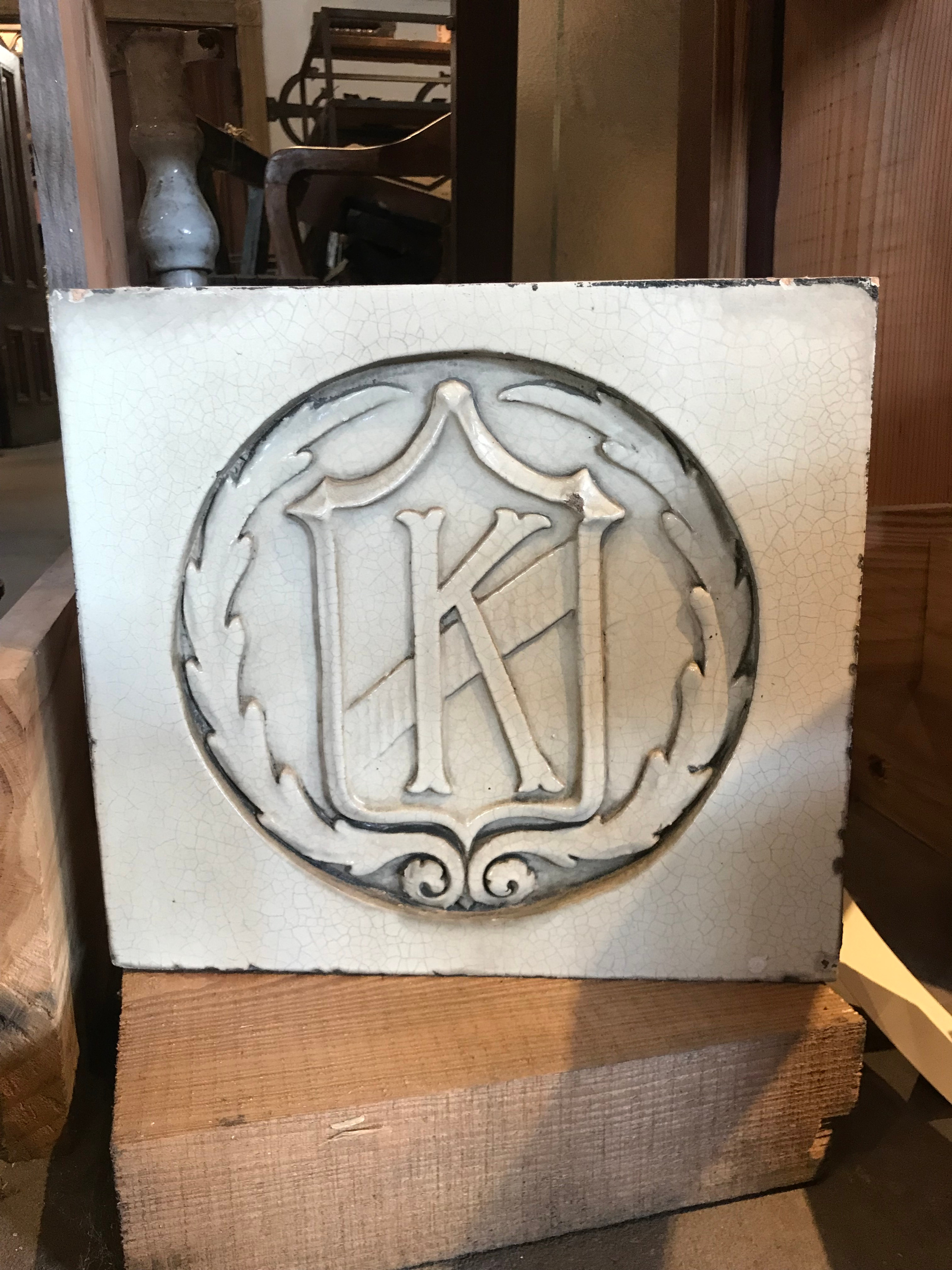 Cast terra cotta block with the initial K for Kingsland Movie Theatre.