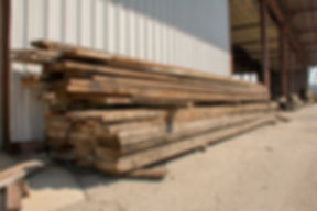 reclaimed lumber waiting to be milled