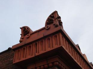 Cast terra cotta decorative parapet caps