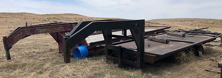J. 20ft GN flatbed trailers w:hay racks.