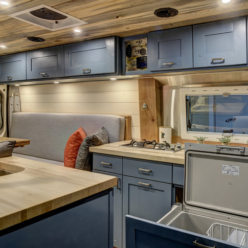 van interior kitchen with fridge open