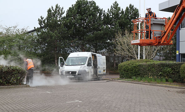 carpark cleaning cherry picker van