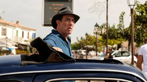 Ciarán Hinds is 'The Man in the Hat'.