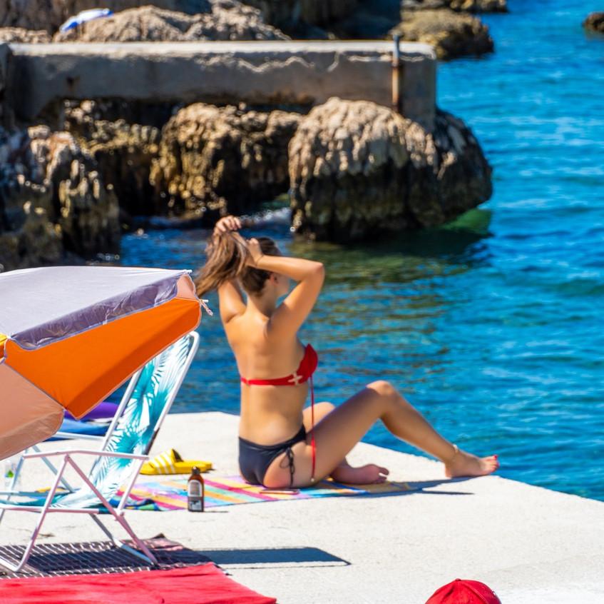 Girl sunbathing on the Makarska beach