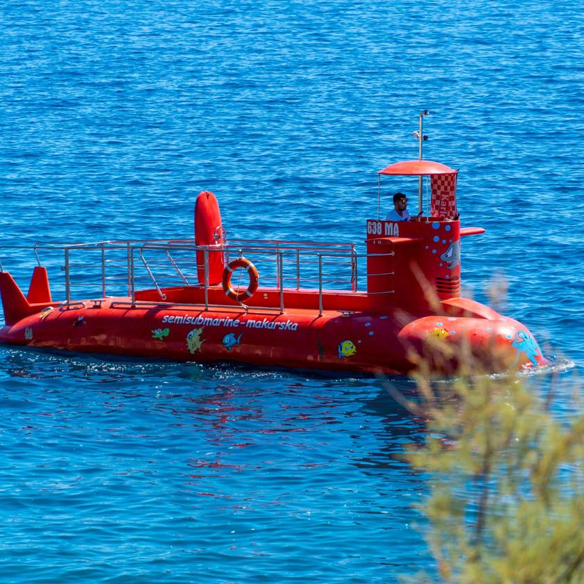 Red submarine in Makarska