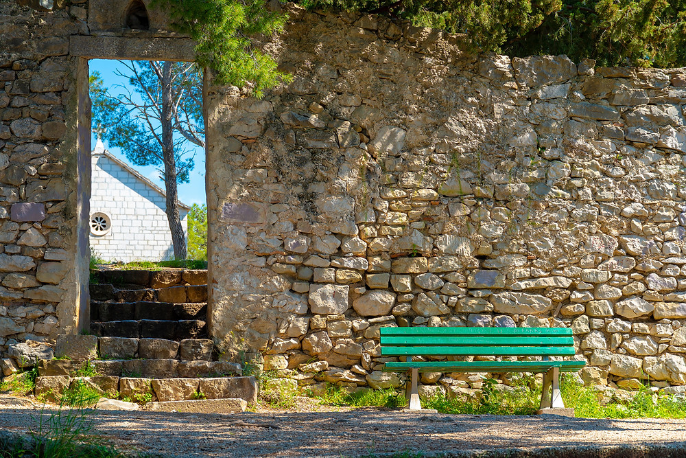 A bench to relax while walking around St Peter's peninsula in Makarska, Croatia