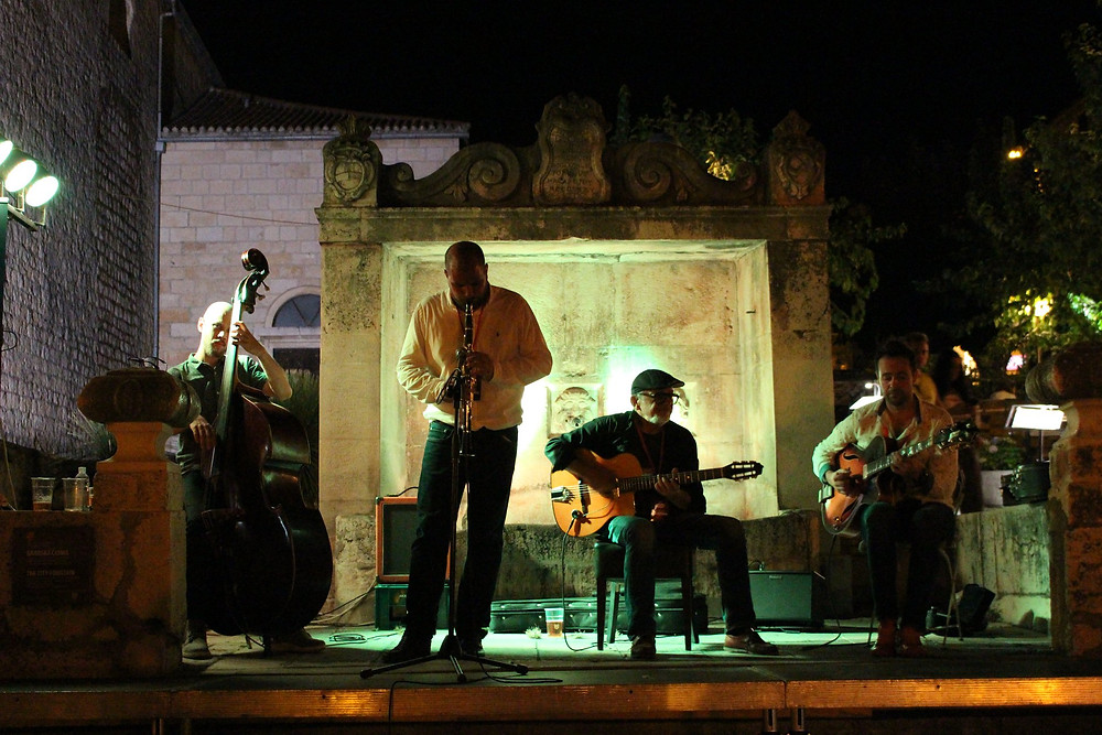 People performing music on Stage of Makarska Jazz Festival in the front of Venetian fountain
