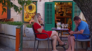 Couple drinking at the Makarska's Hostel Yeti terrace