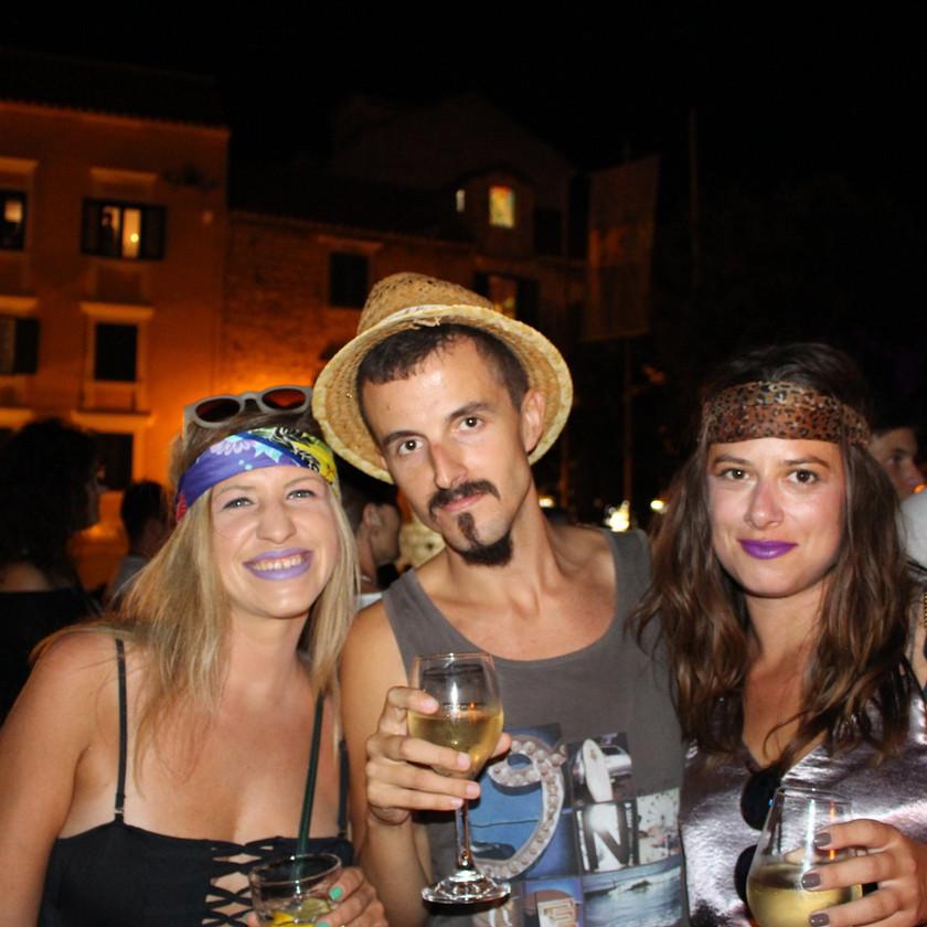 Three friends drinking wine on Kacic Square in Makarska