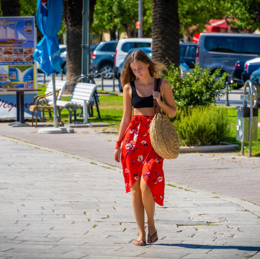 Girl wearing red dress walking in Makarska