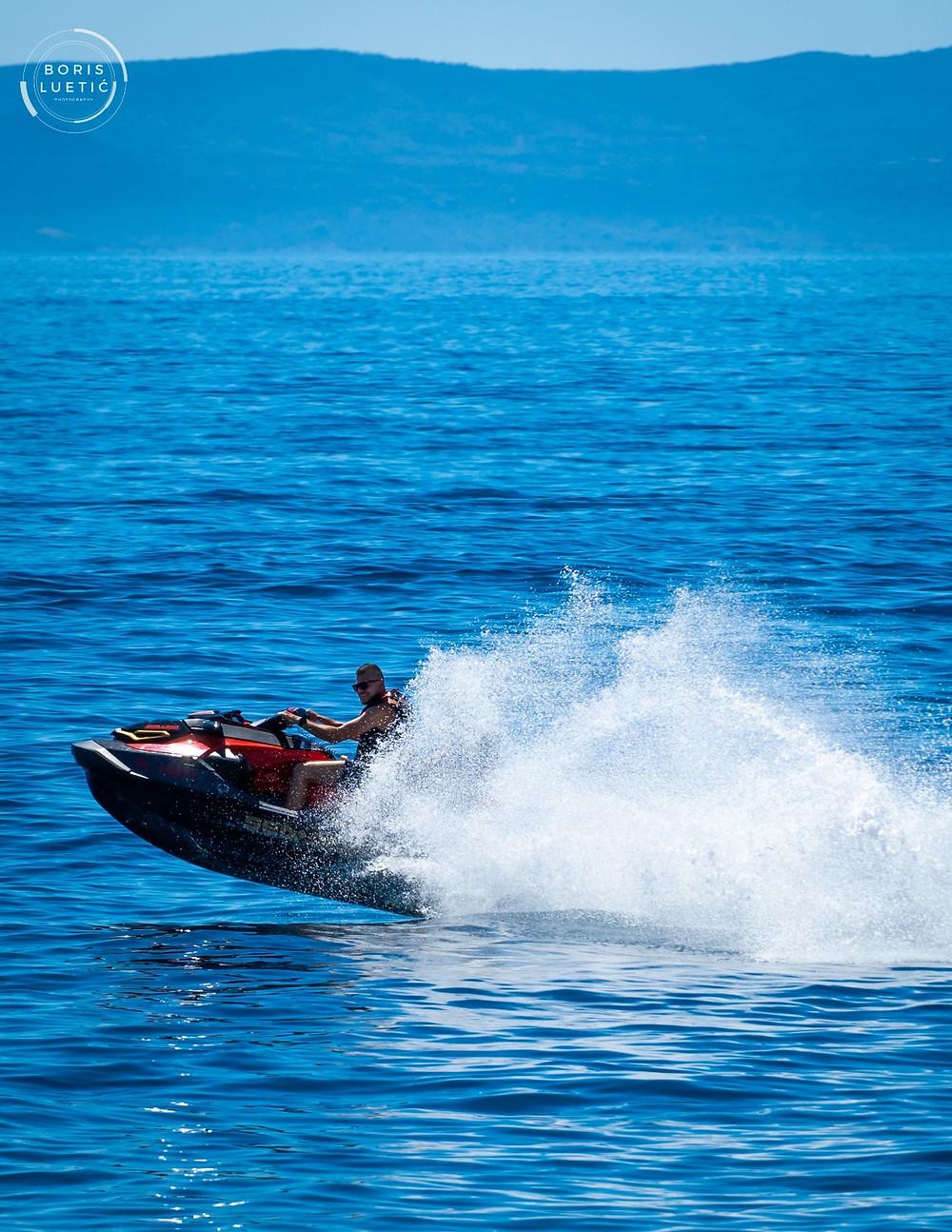 Men enjoying a jet ski ride on the Makarska beach