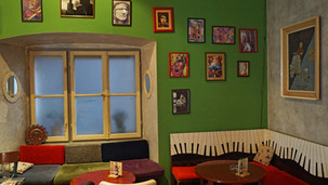 Hostel Yeti in Makarska, cafe bar interior with musical posters on the walls