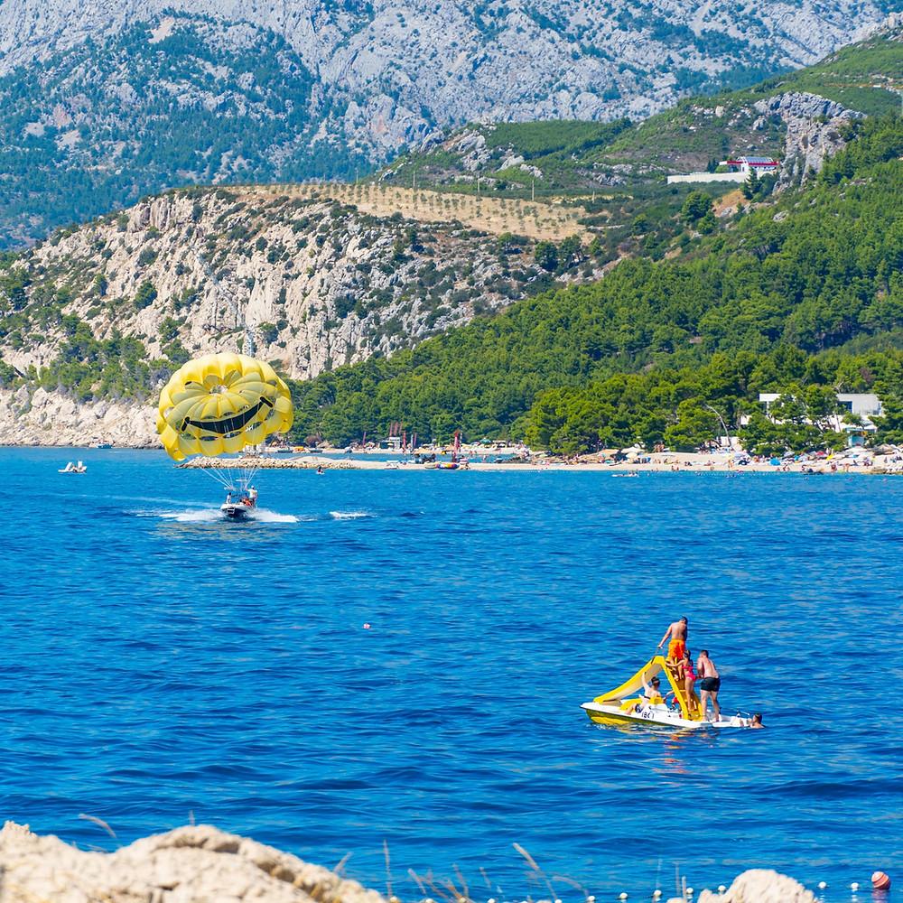 Watersports in Makarska, kids enjoying the summer joys on the beaches of Makarska Riviera