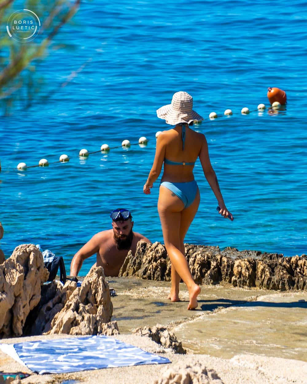 Attractive women in blue bikini having fun on the Makarska beach
