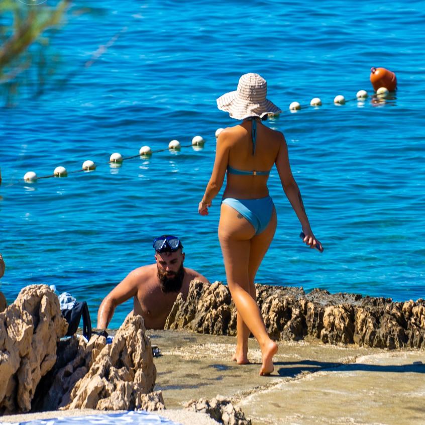 Young people sunbathing on the Makarska beach