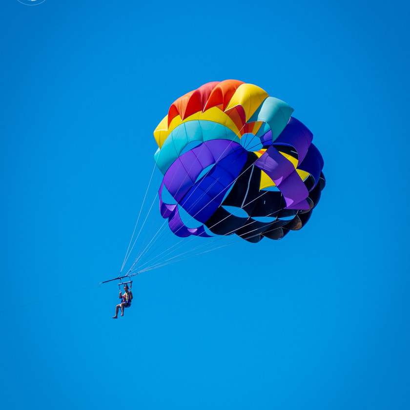 Man flying with a Colorful parachute in Makarska
