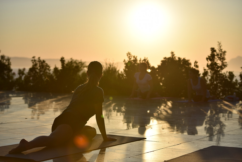 Outdoor yoga class in Podgora near Makarska, Croatia