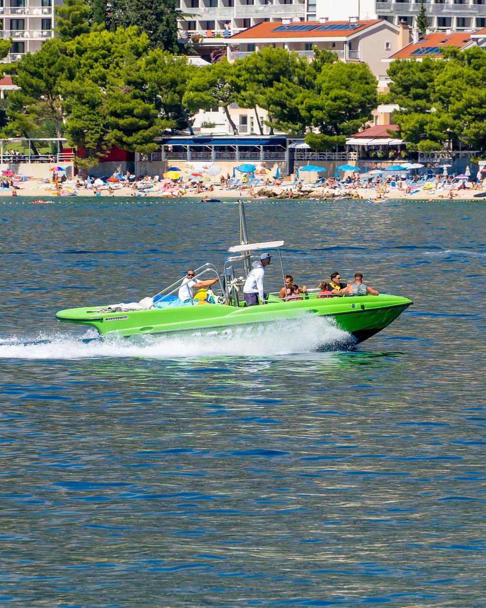 Parasailing speedboat cruising along Makarska Beach