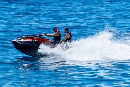 Friends enjoying a jet ski ride on the Makarska beach