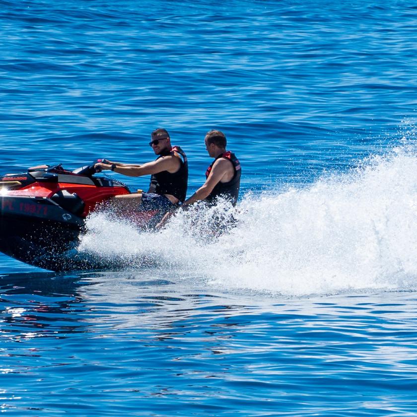Tho friends enjoying a jet ski ride in Makarska