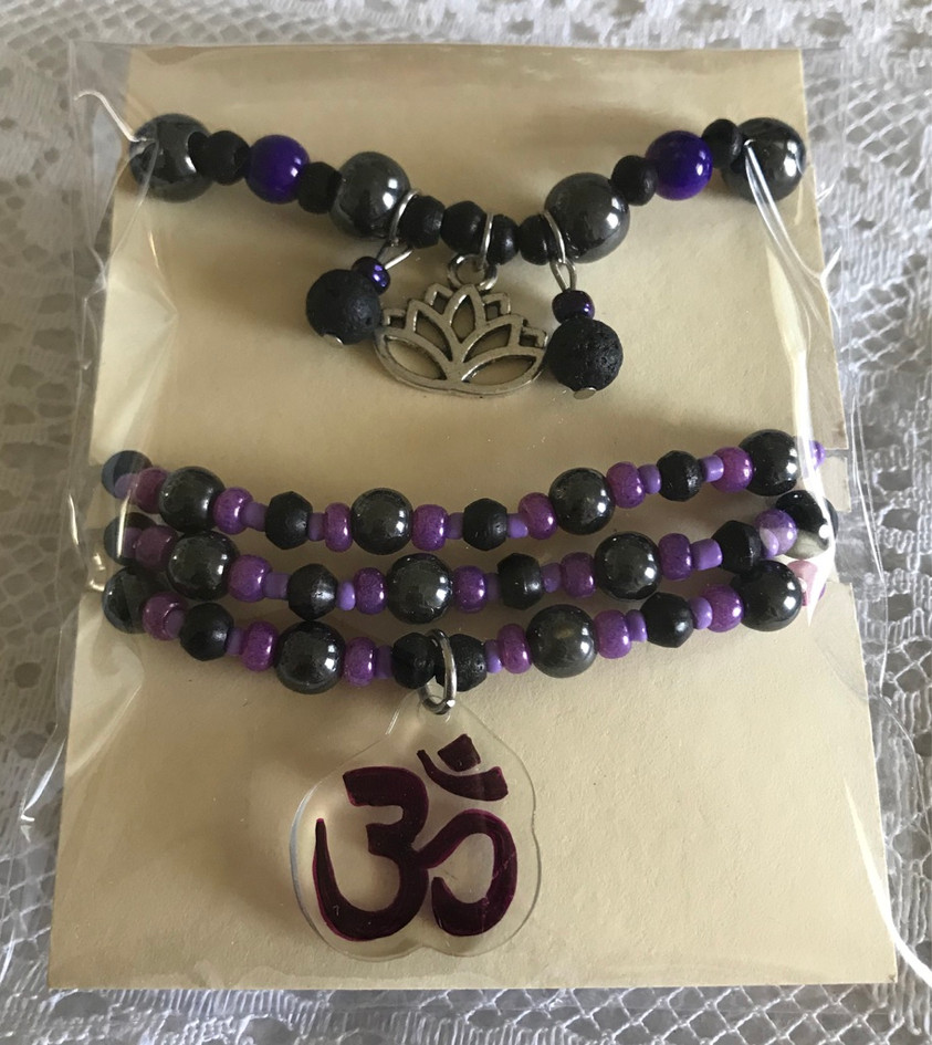Charm bracelets with hematite and lava beads