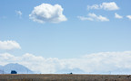 """Huge skies near Omarama, the """"place of light"""", dwarf the distant hills. Omarama is a high, dry plateau and the gliding capital of New Zealand."""