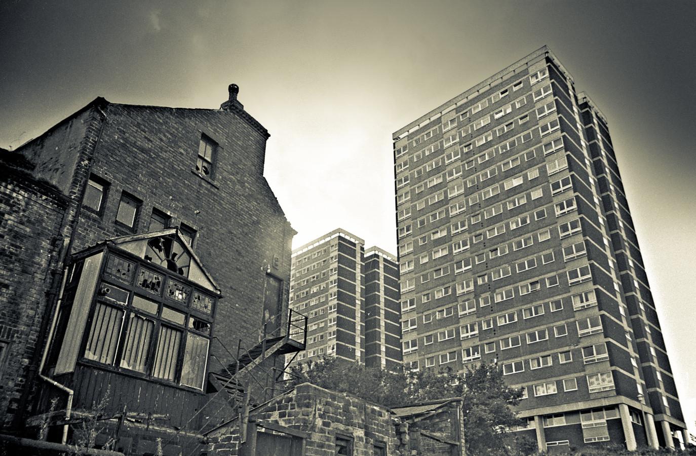 High rise flats loom.