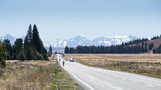 Cyclists brave the heat of the day on their way to Lake Tekapo, a popular tourist destinatuion