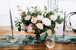 Wooden wedding table setting with bouque