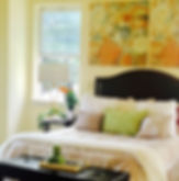 Bright accents with bright warm colors add an feel that you would like to stay in bed and have breakfast, warm and inviting.