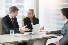 Group of three business partners discuss