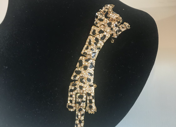 Gold tone crystal pin