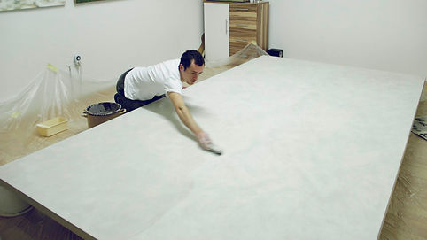 Gregor Smukovic preparing linen canvas with natural glue and Bologna chalk for painting Nymphai Hamadryades