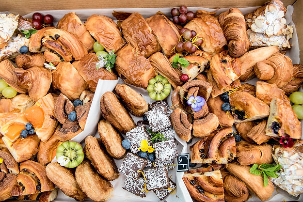 A catering box full of different selection of pastries