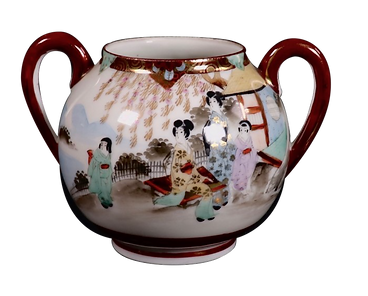 Pot from a porcelain tea set decorated with a Japanese style design.