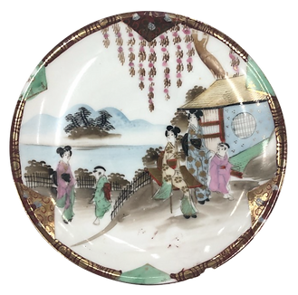 Plate from a porcelain tea set decorated with a Japanese style design.