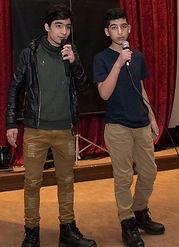 Teenage Boys Singing on Stage